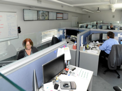 Lincoln Computer Services office showing multiple cubicles with employees at their desks working.