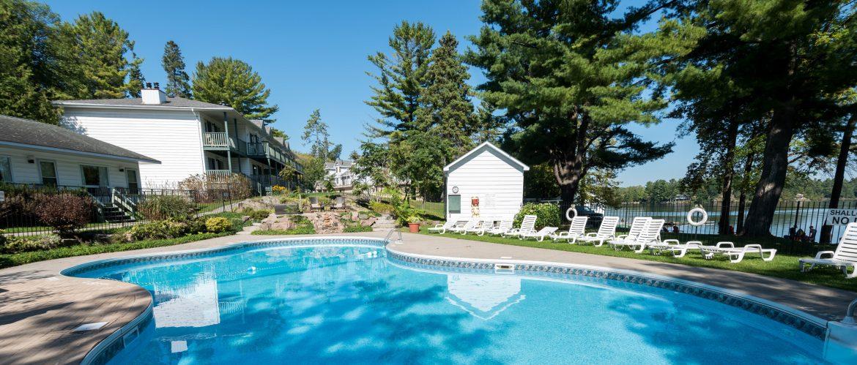 Bayview Wildwood Resort outdoor pool with trees around.