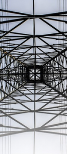 Electro-Federation Canada, the view of a metal power line tower from underneath the center of it.