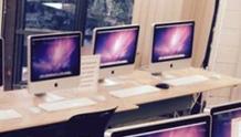 PowerON. 3 Mac computers on a desk.