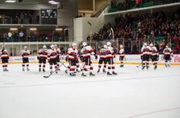 Yardmen Arena. Hockey players on the ice.