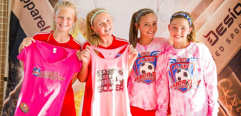 Fine Designs. 4 girls showing off shirts.