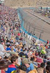 ISM Raceway fans watching a race.