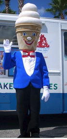 Mister Softee standing in front of an ice cream truck.