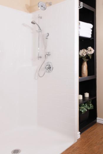 bestbath shower with storage shelf next to it.