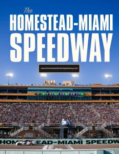 Homestead-Miami Speedway brochure cover showing a photo of the stands full of people and lights on with a blue sky above.