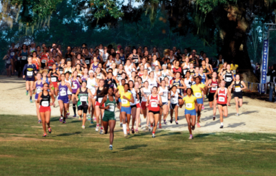 Leon County Florida, a large group of runners in a race wearing racing numbers going towards the camera.