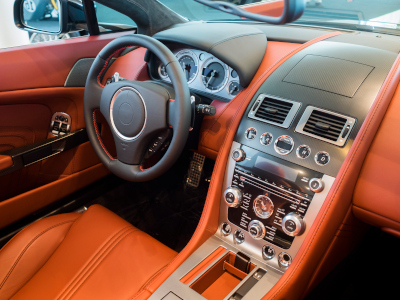 Michelman, interior cockpit of expensive sports car lined in leather and carbon fiber.