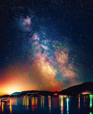 Cowichan Valley Regional District British Columbia stars in the night sky with lights reflecting on the water.