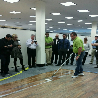 milliCare floor cleaning with people standing around watching.
