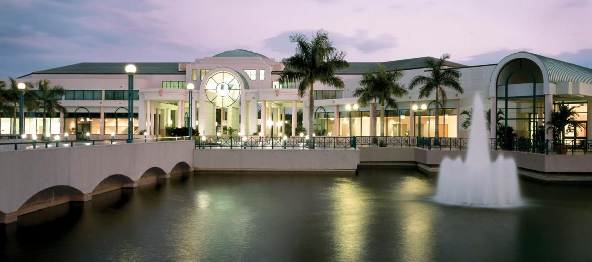 Sunrise Florida, a large public area with a water and a founder to the right of a walkway.