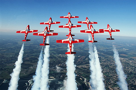 Moose Jaw Saskatchewan Snowbirds in a diamond formation with smoke trailing behind them.