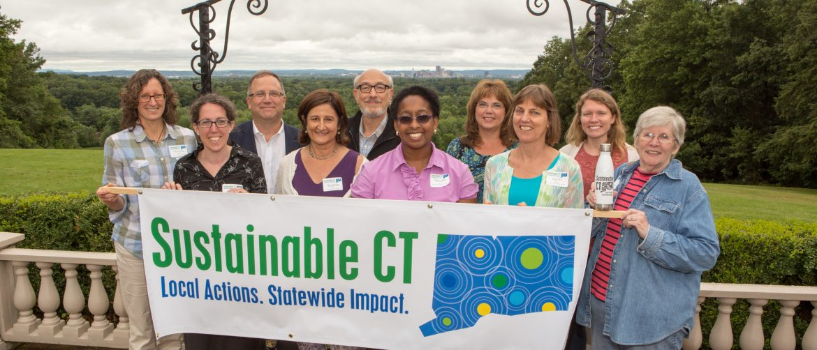 Sustainable CT. A group of people hold up a Sustainable CT banner.