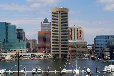 US Green Building Council. Baltimore city view with water and boats in front.