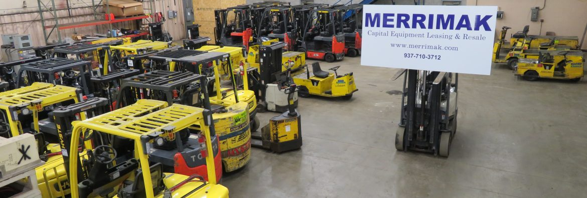 Merrimak Capital Company LLC warehouse showing forklifts and other rental equipment.