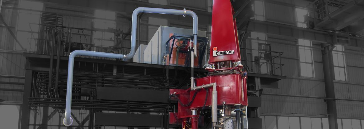Consarc Corporation, example of their product set up showing a tall red piece of machinery with pipes coming off of it.