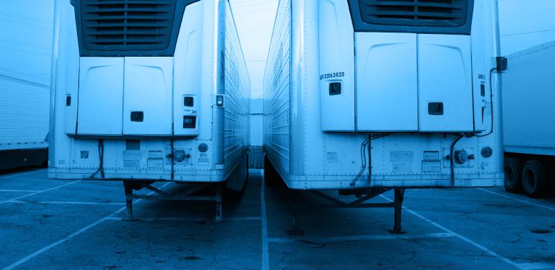 KJM Capital. Parked refrigerated trailers for semi trucks.