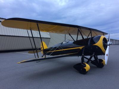 Murfreesboro Municipal Airport, a biplane near hangars.