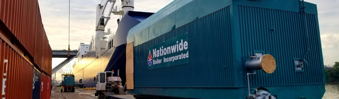 A Nationwide Boiler Inc boiler being loaded onto a ship heading to Saudi Arabia.