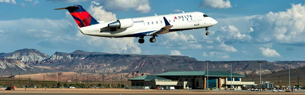 St. George Regional Airport, Delta flight taking off with the airport in the background.