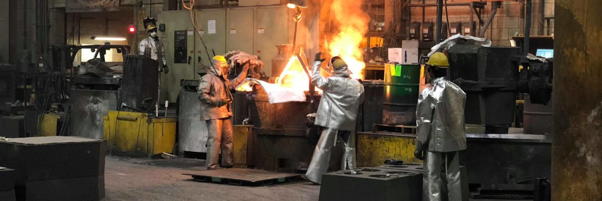 Stainless Foundry & Engineering Inc.; Men working around a smelter with red hot metal in a large building.