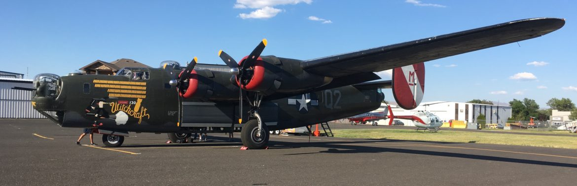Yakima Air Terminal, a B-24 visits the airport. An old B-24 prop aircraft with Witchcraft and a witch on the side.