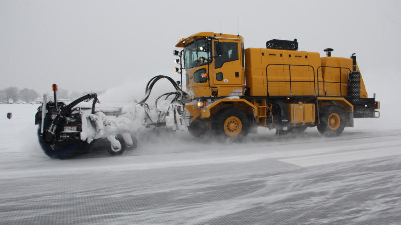 Yakima Air Terminal snow removal vehicle at work on the runway.