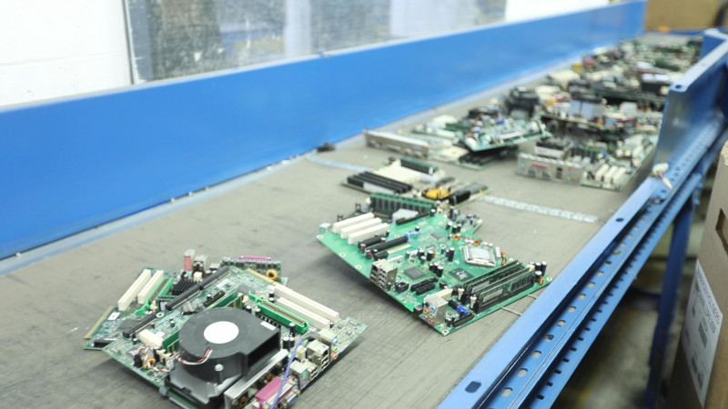 Allocco Recycling and GreenChip. Conveyor belt with electronic components on it.