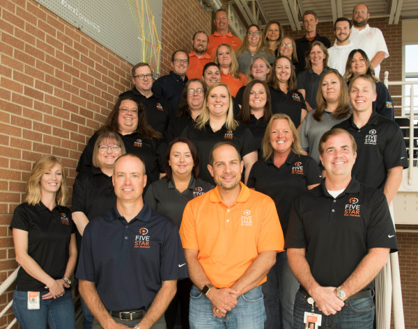 Five Star Call Centers team photo with employees standing on stairs.