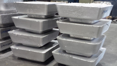 Great Lakes Die Cast Corp. Stacks of metals ingots.