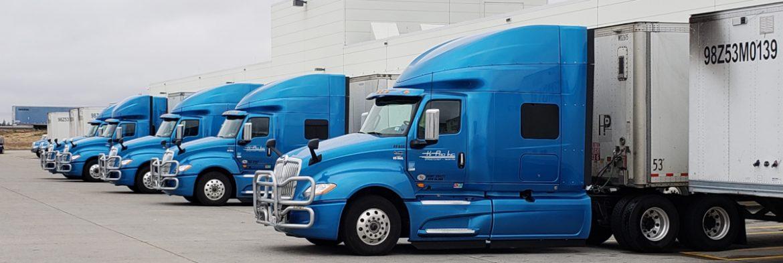 MTC Transportation semi trucks in a row.