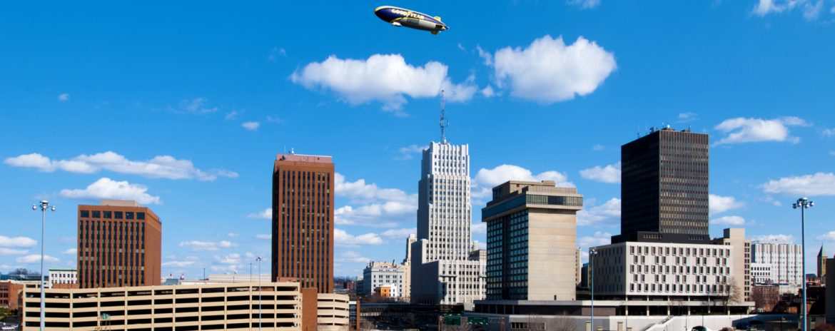 Akron, Ohio skyline with a blimp in the air.