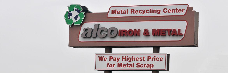 Alco Iron & Metal Company sign.
