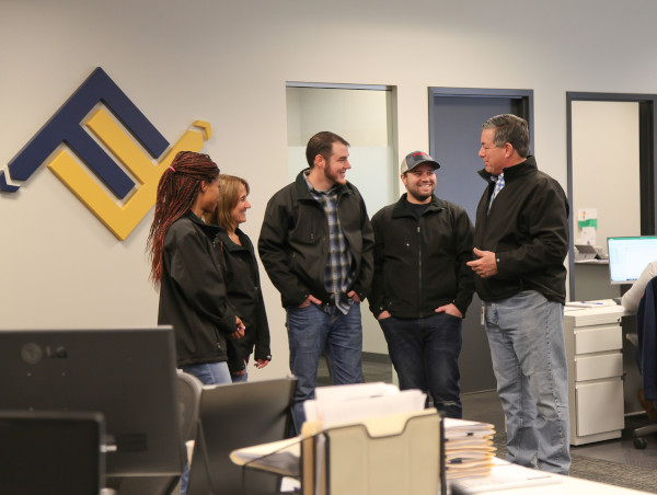 Future Forwarding Company group of office employees talking.