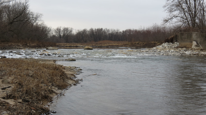 Linn County, Iowa Roller Dam Conversion showing water flowing over rocks.