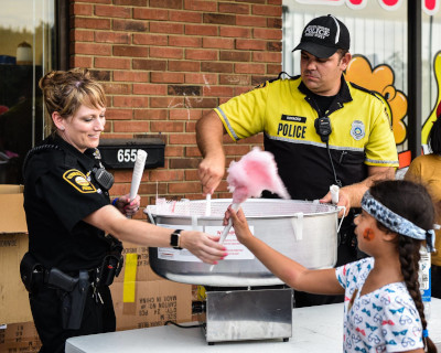 Reynoldsburg, Ohio Police giving out cotton candy to children.