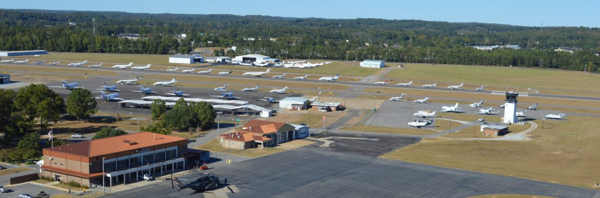 The Tuscaloosa Regional Airport aerial view with lots of airplanes on display on the runway.