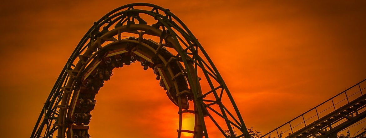 A roller coaster arching with orange sky behind. Amusement Parks Market Worth $70.83 Billion by 2025