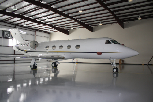 Thomasville Regional Airport jet inside of a hangar.