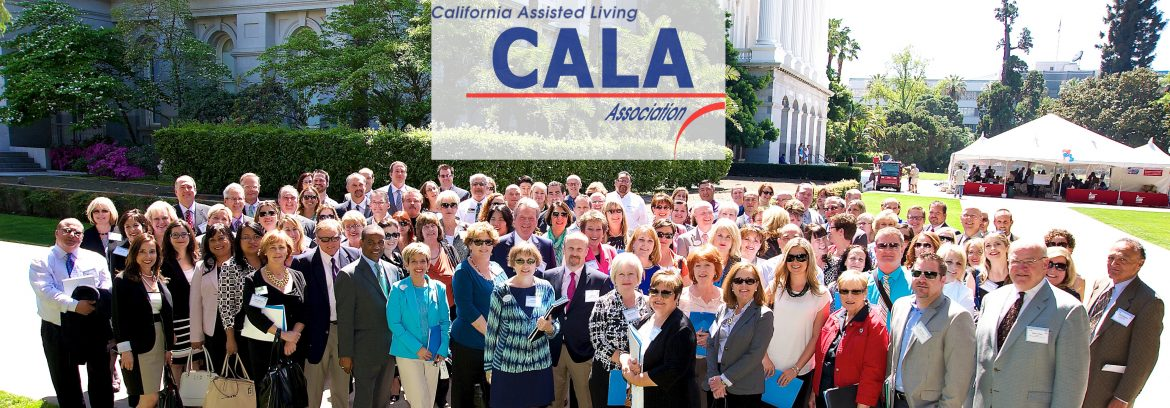 California Assisted Living Association group of members posing for a photo and a logo for CALA located above them in the photo.
