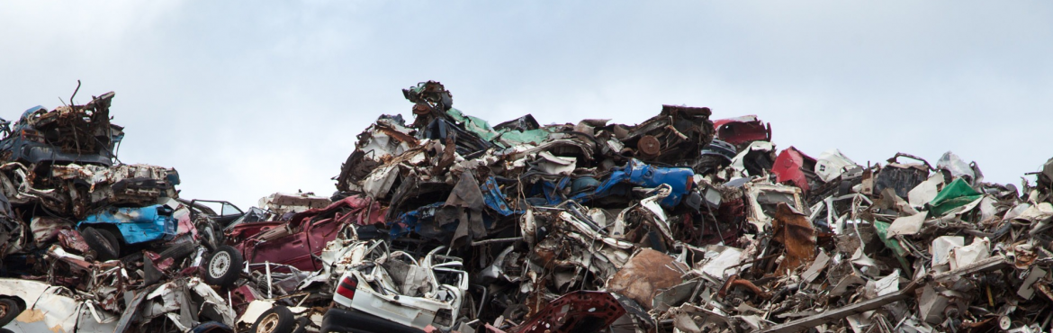 Edward Arnold Scrap Processors, Inc.; A pile of scrap metal with parts of vehicles visible.