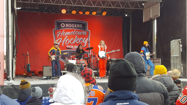 Lacombe, Alberta Hometown Hockey Tour with female musicians on stage performing.