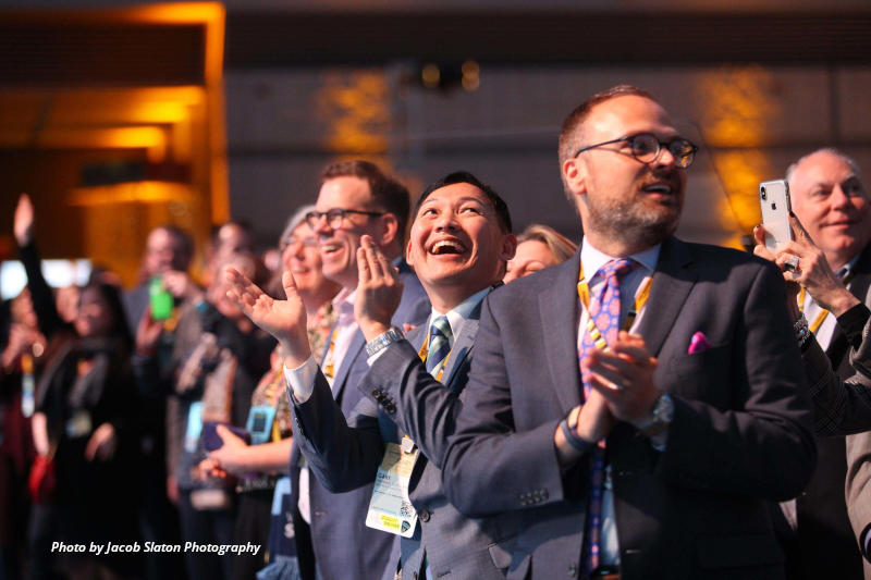PCMA Convening Leaders in Pittsburgh 2019, clapping hands and smiling.