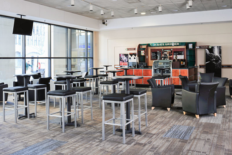 SeaGate Convention Centre, SeaGate Lobby interior with tall chairs and lounge chairs..