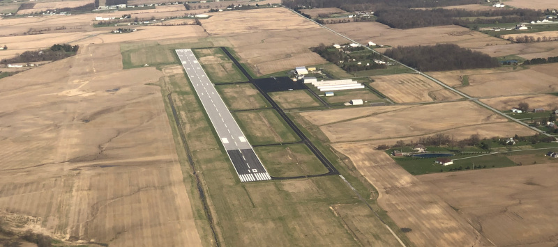 Allen County Regional Airport aerial view of the runway and surrounding area.