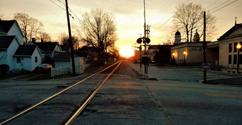 Wabash, Indiana railroad tracks going between houses at sunset.