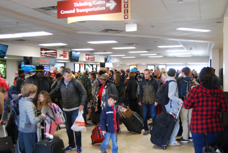 Yampa Valley Regional Airport's busy baggage claim area.