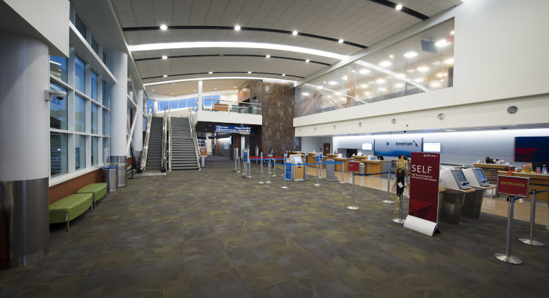 Albert J. Ellis Airport (AOJ) Terminal interior showing check in counters for American Airlines and Delta.