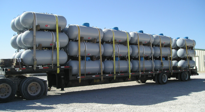 BLT Tanks semi trailer loaded with stacks of tanks.