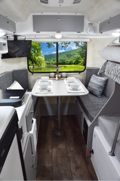 Casita Enterprises Inc., inside of a Heritage trailer showing the kitchen and dining room section.